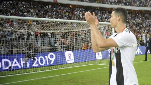 Cristiano Ronaldo of Juventus acknowledges the fans as he celebrates after winning the Italian Supercup match between Juventus and AC Milan at King Abdullah Sports City on January 16, 2019 in Jeddah.