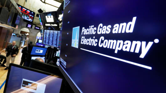 The logo for Pacific Gas & Electric Co. appears above a trading post on the floor of the New York Stock Exchange, Monday, Jan. 14, 2019.