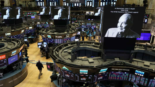Screens display a tribute to Jack Bogle, founder and retired CEO of The Vanguard Group, on the floor of the New York Stock Exchange (NYSE) in New York, January 17, 2019.