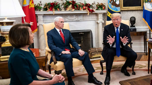 President Donald J. Trump debates with House Minority Leader Nancy Pelosi, D-Calif., as Vice President Mike Pence listens during a meeting in the Oval Office of White House on Tuesday, Dec. 11, 2018 in Washington, DC.