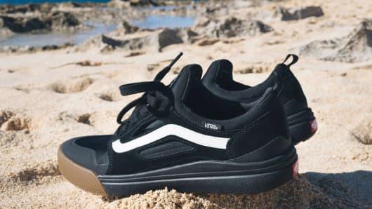 Vans sneakers on beach
