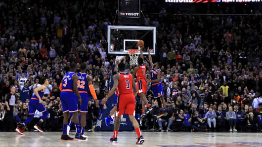 Washington Wizard's Thomas Bryant (second right) shoots only to be Goaltending fouled for the winning points during the NBA London Game 2019 at the O2 Arena, London.
