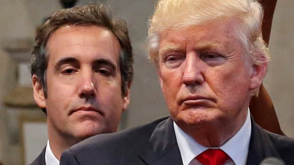 Republican presidential nominee Donald Trump's personal attorney Michael Cohen stands behind Trump.
