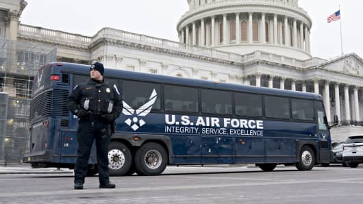 An Air Force bus intended to be used by members of Congress sits outside the U.S. Capitol in Washington, D.C., U.S., on Thursday, Jan. 17, 2019.
