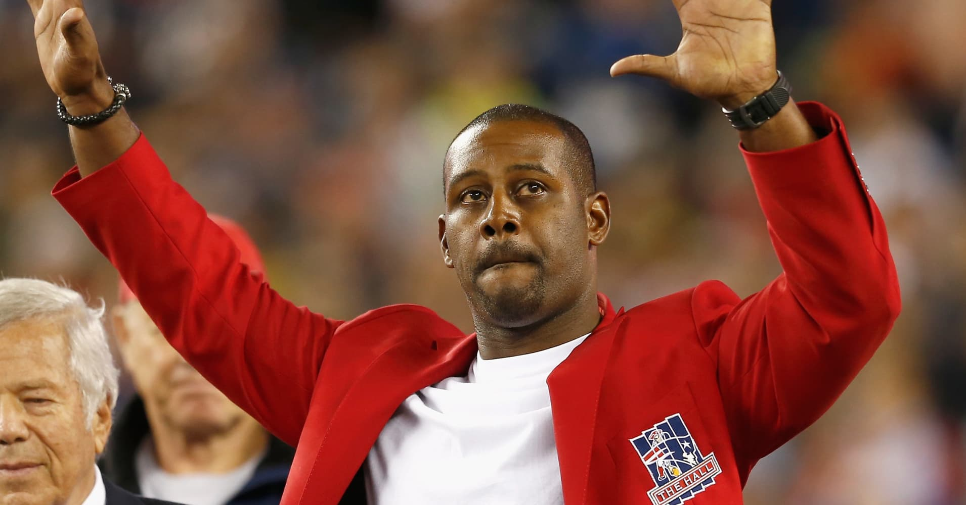 Former player Ty Law off the New England Patriots is recognized in a halftime ceremony during a game against the  New York Jets at Gillette Stadium on October 16, 2014 in Foxboro, Massachusetts.