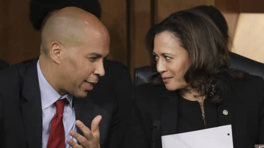 Sen. Cory Booker (D-NJ) and Sen. Kamala Harris (D-CA) talk with each other as they listen to Supreme Court nominee Judge Brett Kavanaugh testify before the Senate Judiciary Committee on the third day of his Supreme Court confirmation hearing on Capitol Hill September 6, 2018 in Washington, DC.