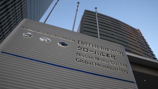 Logos for Nissan Motor Co., left, Infiniti, center, and Datsun displayed outside the Nissan headquarters in Yokohama, Japan, on Sunday, Jan. 20, 2019.