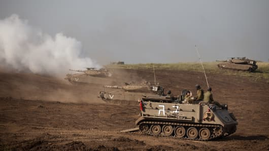 Israeli Merkava tanks participate in a drill near the border with Syria at the Israeli-annexed Golan Heights on May 6, 2013.
