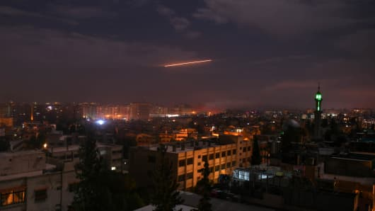 A picture taken early on January 21, 2019 shows Syrian air defence batteries responding to what the Syrian state media said were Israeli missiles targeting Damascus.