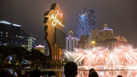 People use mobile devices to take photographs of a fountain outside the Wynn Macau casino resort, operated by Wynn Resorts Ltd., in Macau, China, on Tuesday, Jan. 30, 2018.