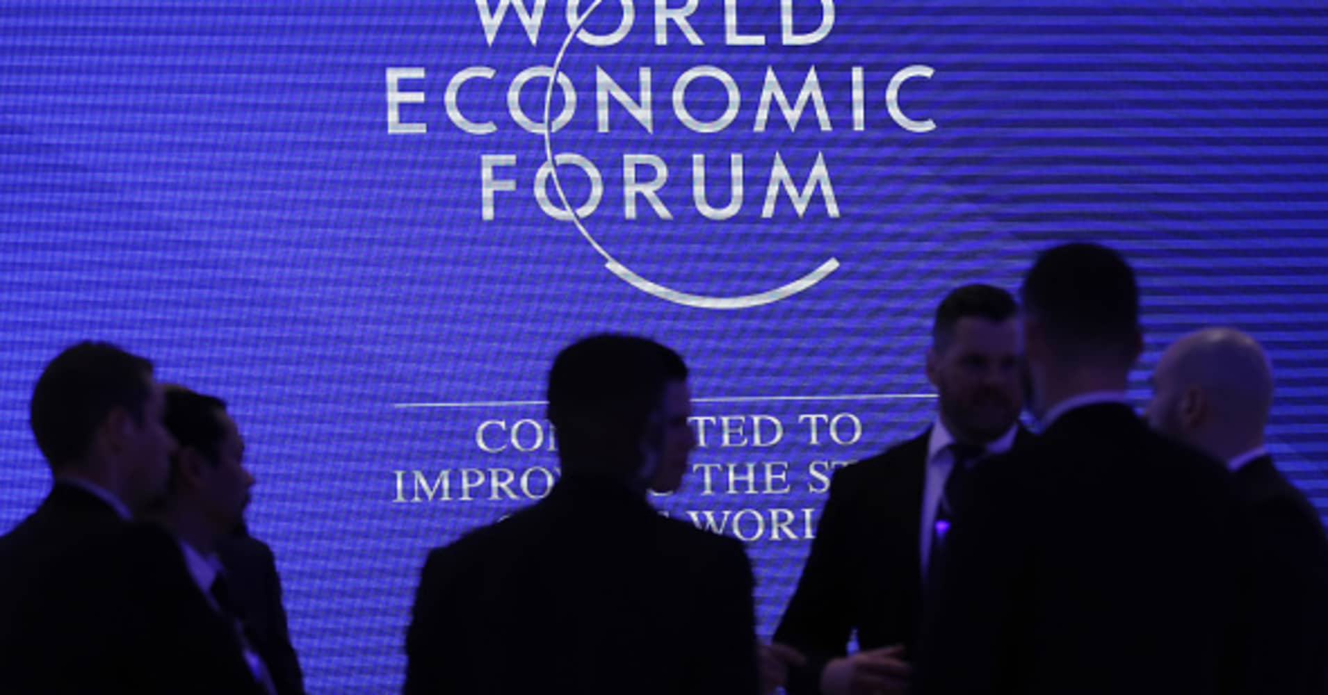 Workers listen during a briefing inside the Congress Center, the venue for the World Economic Forum (WEF), in Davos, Switzerland, on Sunday, Jan. 20, 2019.