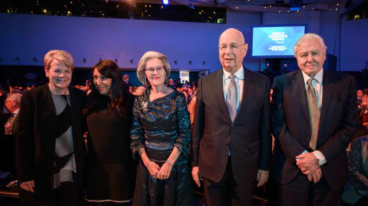 Marin Alsop (L), Haifaa Al Mansour (2nd L), Hilde Schwab (C), Klaus Schwab (2nd R) and David Attenborough (R) pose during a ceremony ahead of WEF 2019 meeting, on January 21, 2019 in Davos.