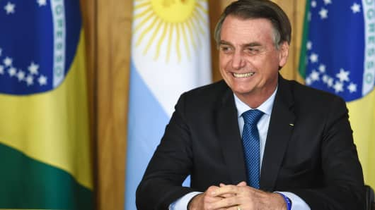 Brazilian President Jair Bolsonaro is pictured during the signing of an agreement with Argentina's President Mauricio Macri (out of frame) at Planalto Palace in Brasilia, on January 16, 2019