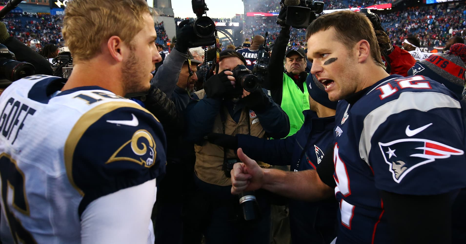 Jared Goff #16 of the Los Angeles Rams greets Tom Brady #12 of the New England Patriots.