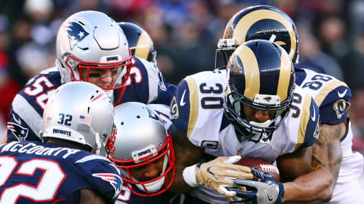 Todd Gurley #30 of the Los Angeles Rams is tackled during the game against the New England Patriots at Gillette Stadium on December 4, 2016 in Foxboro, Massachusetts.