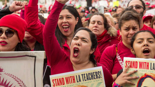 Demonstrators hold signs and shout slogans during a teachers strike in Los Angeles, California, Jan. 18, 2019.