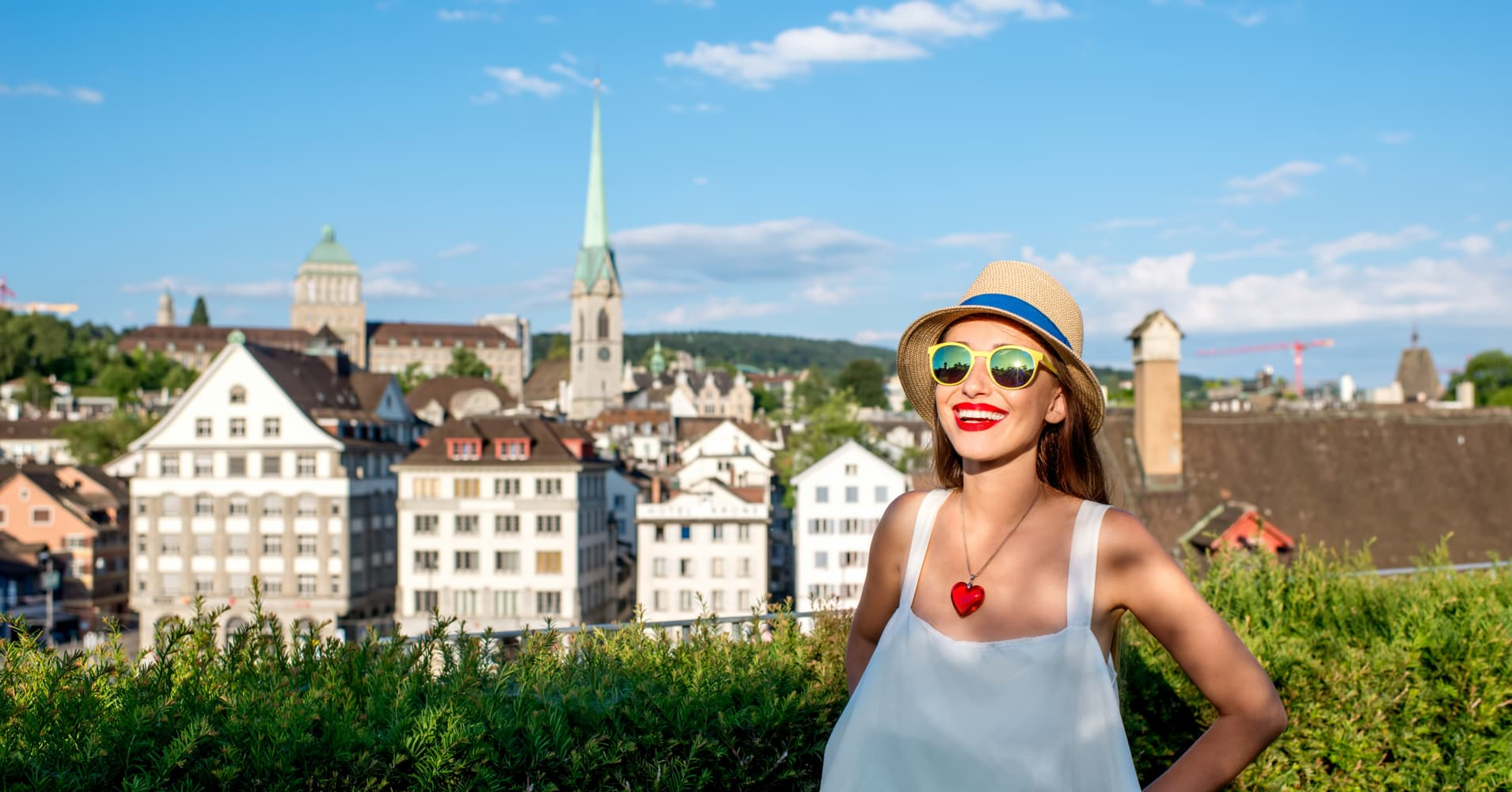 A tourist stands in Zurich, Switzerland.