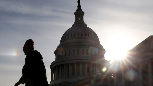 A visitor walks by the U.S. Capitol in Washington, January 22, 2019.
