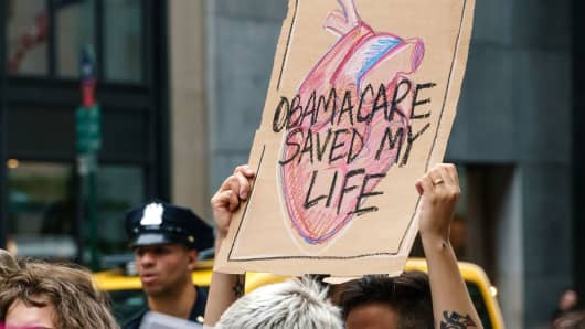 Participants reason signs in New York, NY while protesting efforts to dissolution and deputy of a Affordable Care Act on Jul 29, 2017.