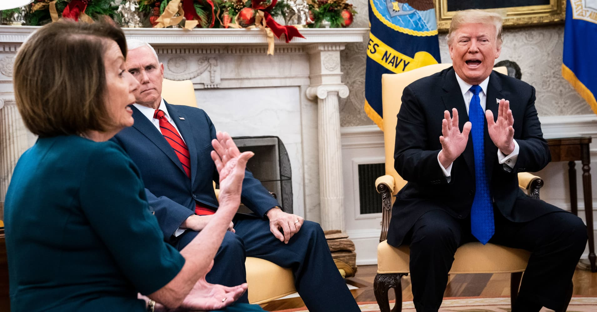 President Donald J. Trump debates with House Minority Leader Nancy Pelosi, D-Calif., left, as Senate Minority Leader Chuck Schumer, D-N.Y., and Vice President Mike Pence listen during a meeting in the Oval Office of White House on Tuesday, Dec. 11, 2018 in Washington, DC.