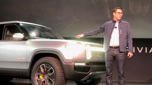 Rivian CEO RJ Scaringe with R1T electric pickup at the 2019 LA Auto Show.