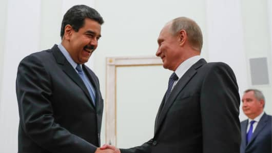 Venezuela's President Nicolas Maduro shakes hands with his Russia counterpart Vladimir Putin during a meeting at the Moscow Kremlin.