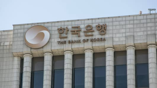 Signage for Bank of Korea (BOK) is displayed atop the central bank's headquarters building in Seoul, South Korea, on Thursday, Aug. 16, 2018.