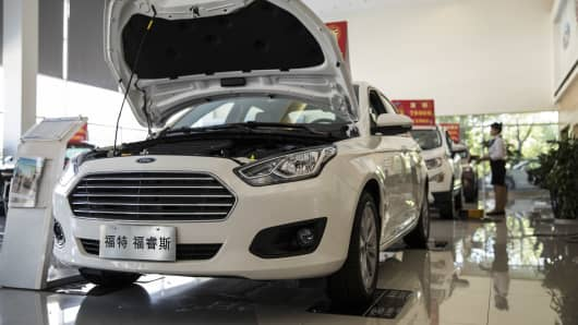 A Ford Escort on display at a Ford dealership in Shanghai, China, on Thursday, July 19, 2018.