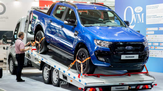 At Ford's stand at the IAA Commercial Vehicles, an off-road vehicle of the Ford Ranger type is on a Ford Transit van.