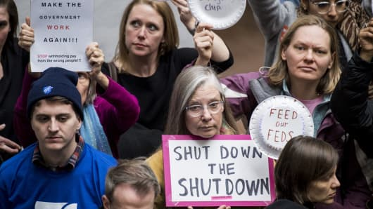 Federal workers and contractors, along with their unions, stage a protest calling for and end to the government shutdown and back pay in the Hart Senate Office Building on Wednesday, Jan. 23, 2019.