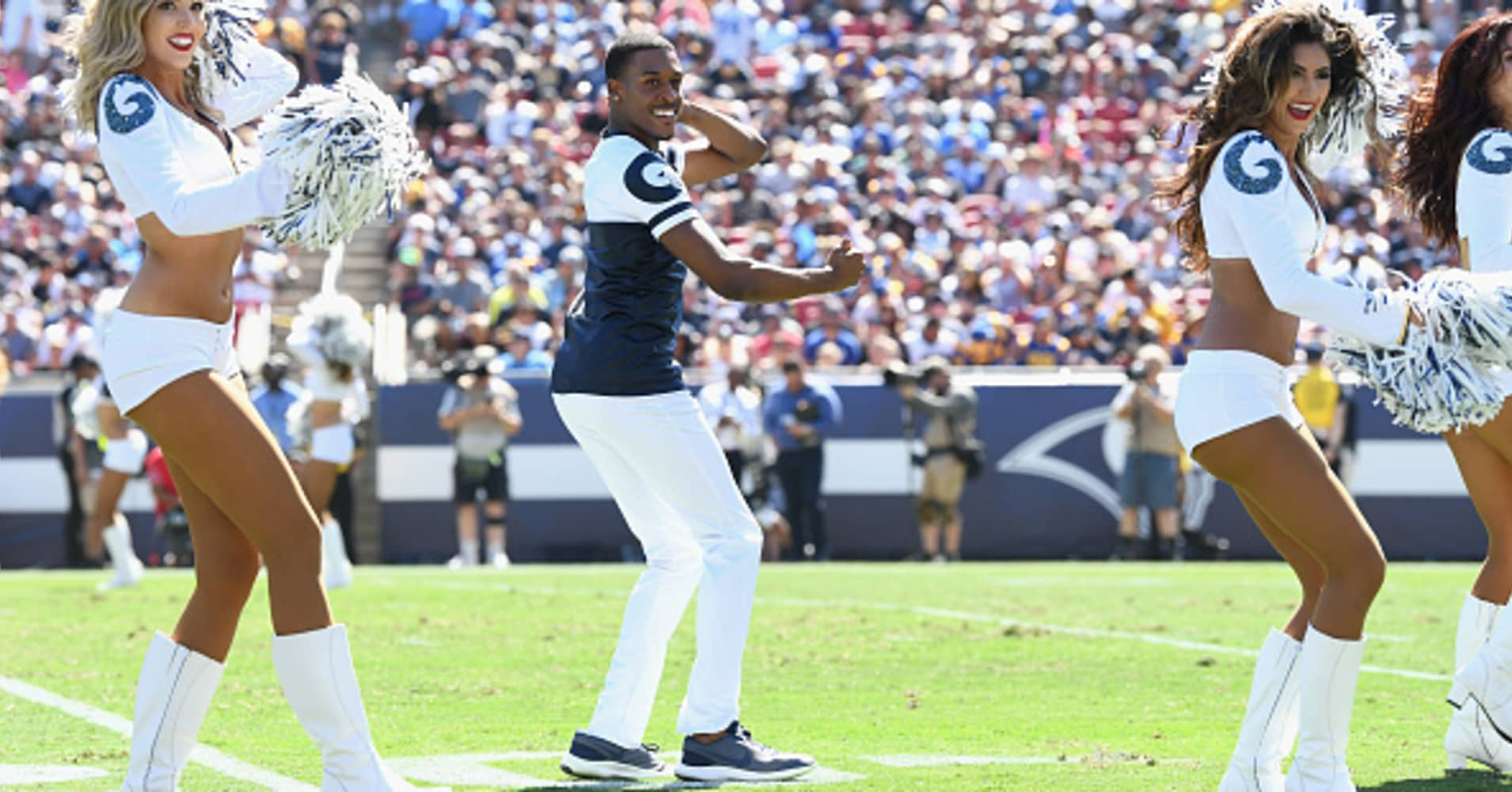 Cheerleader Quinton Peron performs during halftime of the game against the Los Angeles Chargers at Los Angeles Memorial Coliseum on September 23, 2018 in Los Angeles, California.