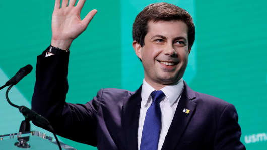 2020 presidential candidate South Bend (IN) Mayor Pete Buttigieg waves after delivering remarks at the United States Conference of Mayors winter meeting in Washington, January 24, 2019.