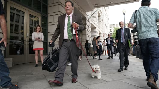 Randy Credico leaves with his dog Bianca from the U.S. District Court, September 7, 2018 in Washington, DC.
