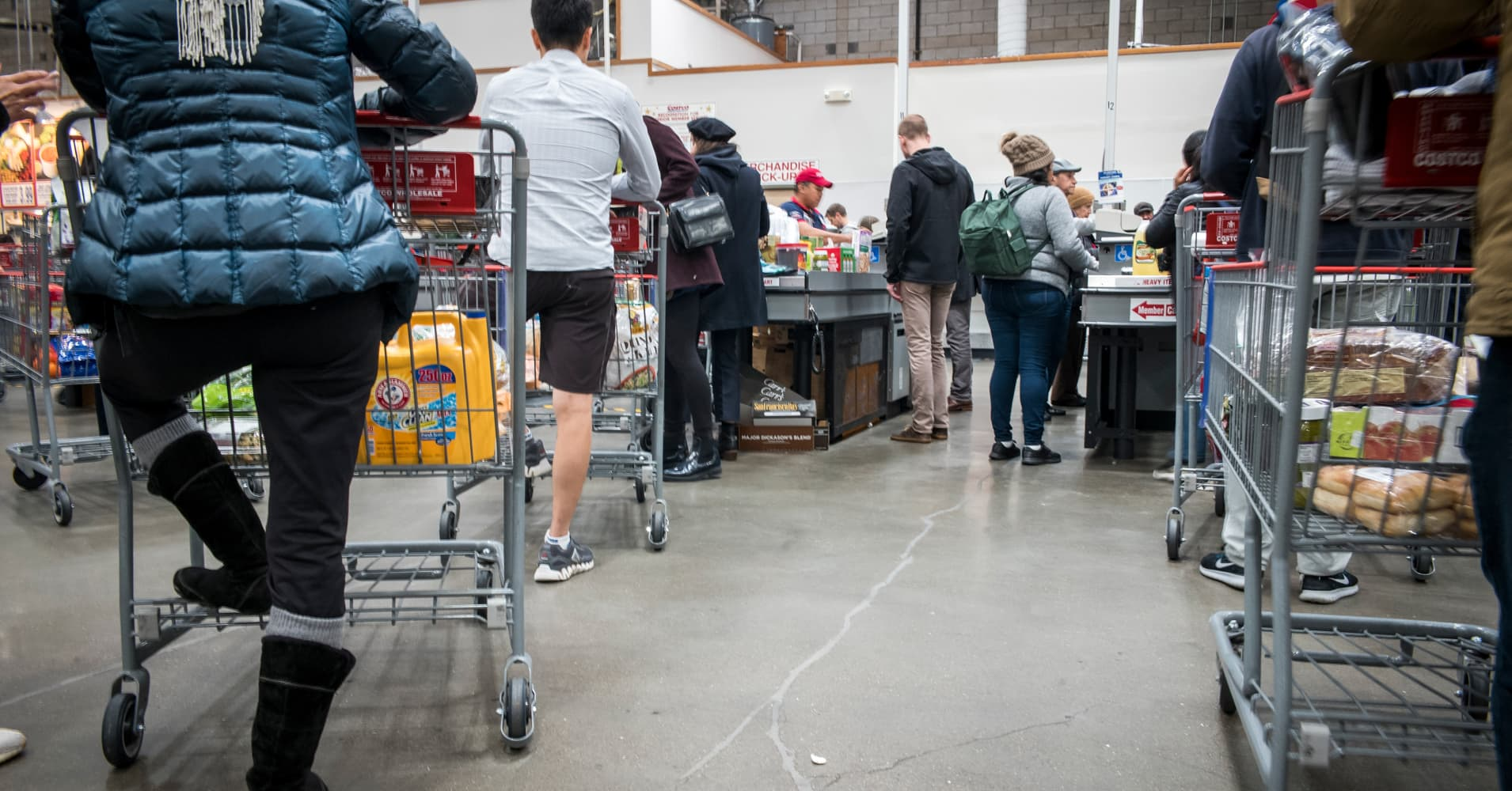 Customers wait in line to check-out at a Costco Wholesale Corp. store in San Francisco in December 2018.