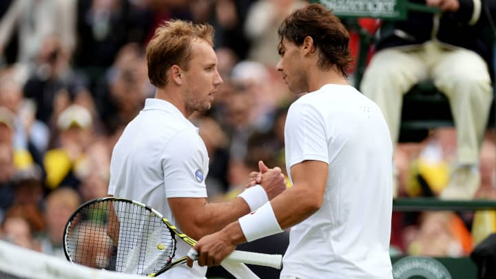 LONDON, ENGLAND - JUNE 24:  Steve Darcis of Belgium shakes hands at the net with Rafael Nadal of Spain after their Gentlemen's Singles first round match on day one of the Wimbledon Lawn Tennis Championships at the All England Lawn Tennis and Croquet Club on June 24, 2013 in London, England.
