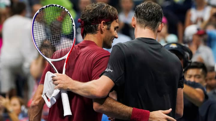 TOPSHOT - Australia's John Millman (R) hugs Switzerland's Roger Federer after defeating him during their 2018 US Open Men's Singles tennis match at the USTA Billie Jean King National Tennis Center in New York on September 3, 2018. - Five-time champion Roger Federer crashed out of the US Open fourth round, beaten in four sets by 55th-ranked Australian John Millman.