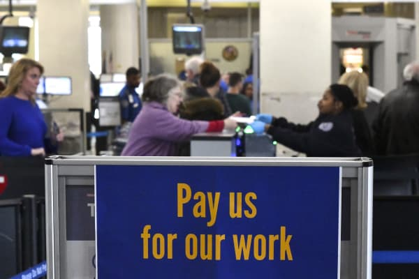 A placard stating 'Pay us for our work' is displayed on a security line after Philadelphia Airport TSA and airport workers held a protest rally outside the Philadelphia International Airport on January 25, 2019 in Philadelphia, Pennsylvania.