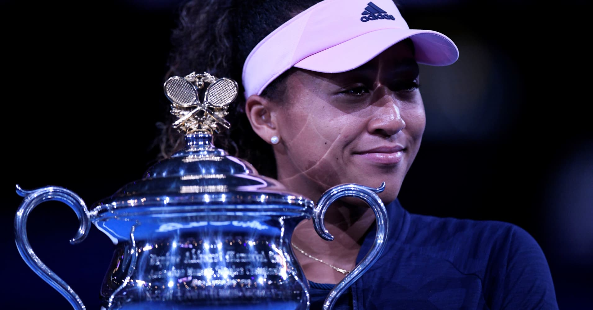 Naomi Osaka of Japan poses with the trophy after winning her Women's Singles Final match against Petra Kvitova