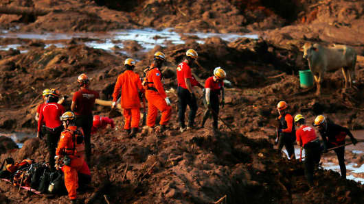 The members of the rescue team are looking for victims after flour, owned by the Brazilian mining company Vale SA, in Bramadinho, Brazil, crashed, 28 January 2019