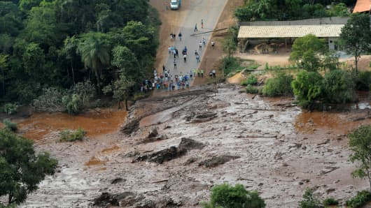 Residents are seen in an area next to a dam owned by Brazilian miner Vale SA that burst, in Brumadinho, Brazil January 25, 2019.