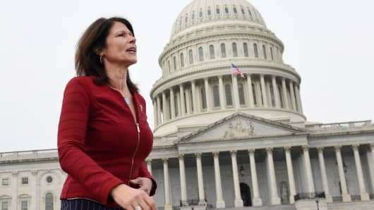 Rep. Cheri Bustos, D-Ill., walks to a group photo with the women of the 116th Congress on Capitol Hill in Washington, Friday, Jan. 4, 2019.