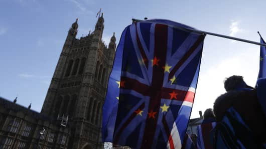 A British Union flag, also known as Union Jack, hovers in front of the Houses of Parliament in London (United Kingdom) on Tuesday, January 22, 2019, alongside the flag of the European Union (EU) during an ongoing protest demonstration against Brexit ,