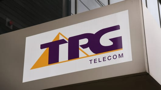 A TPG Telecom sign adorns the side of their headquarters in Melbourne on August 30, 2018.