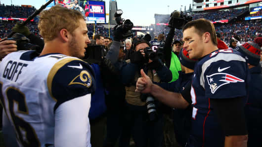 Jared Goff #16 of the Los Angeles Rams greets Tom Brady #12 of the New England Patriots after the New England Patriots defeated the Los Angeles Rams 26-10 at Gillette Stadium on December 4, 2016 in Foxboro, Massachusetts.