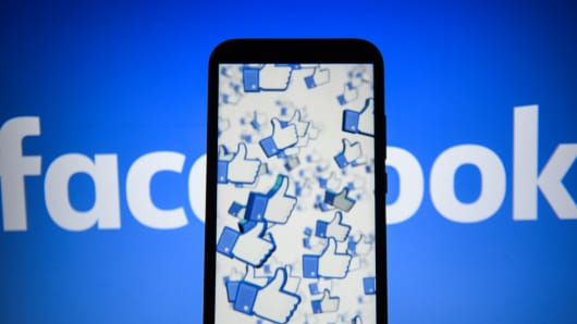 Facebook likes logo are seen on an android mobile phone.