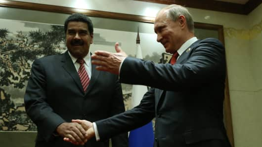 Russian President Vladimir Putin (R) and President of Venezuela Nicolas Maduro (L) speak at a bilateral meeting on September 3, 2015 in Beijing, China.