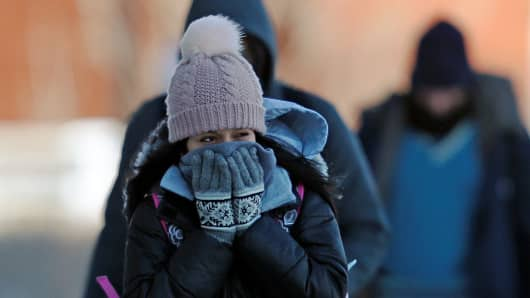 A student reacts to subzero temperatures while walking to class at the University of Minnesota in Minneapolis, Minnesota, U.S., January 29, 2019.