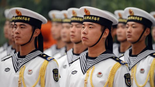 Chinese sailors form an honor guard during a welcoming ceremony on September 6, 2012 in the Great Hall of the People in Beijing.