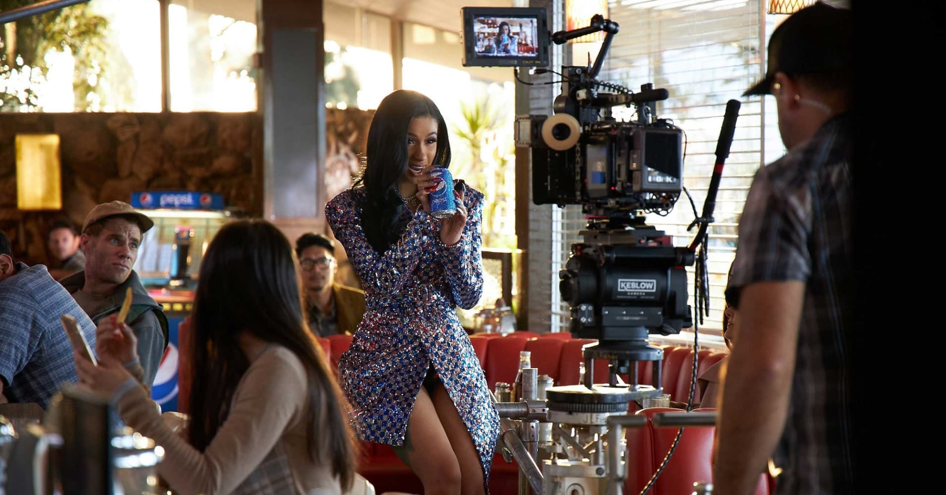 Cardi B films a Super Bowl commercial for Pepsi.