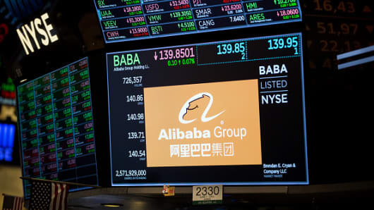 A monitor displays Alibaba Group Holding Ltd. signage on the floor of the New York Stock Exchange (NYSE) in New York, U.S., on Monday, Jan. 7, 2019.